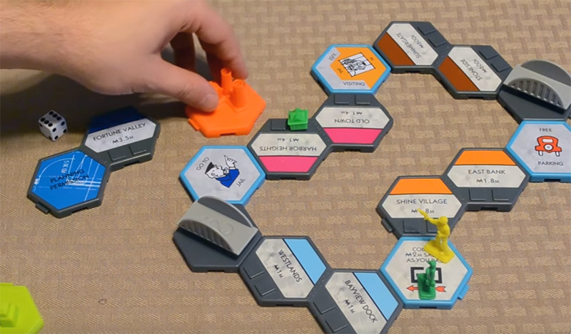 A player puts together the U-Build Monopoly game