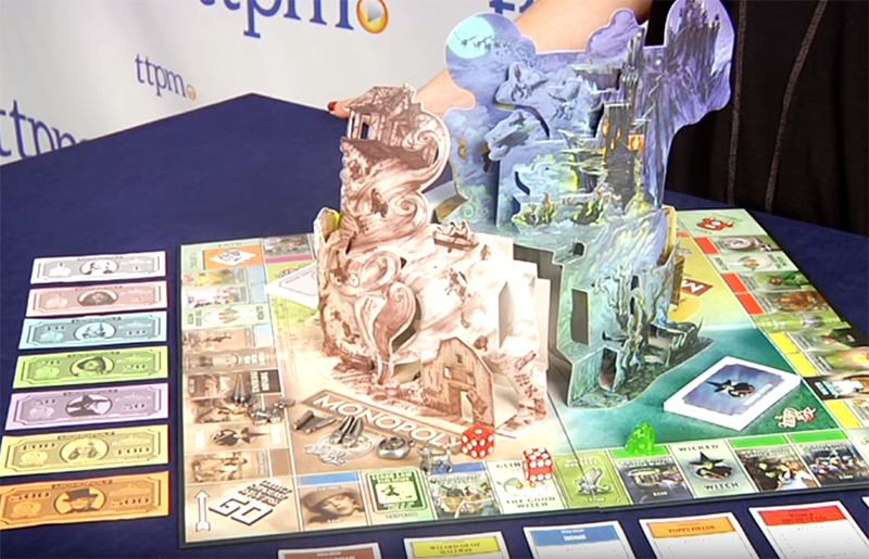 A pop-up tornado and witch castle centers the Monopoly Wizard Of Oz game