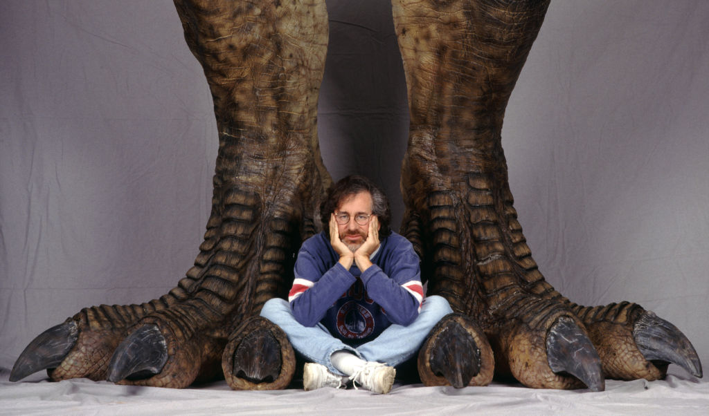 steven spielberg at the foot of a t-rex