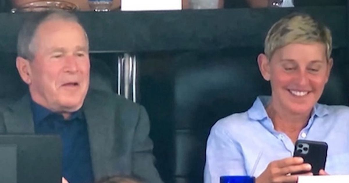George W. Bush sits at the Dallas Cowboy game laughing with Ellen DeGeneres