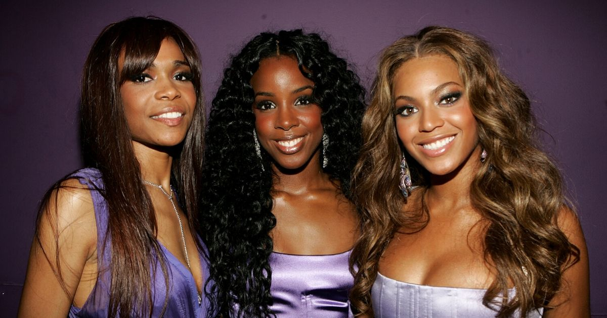 Singers Michelle Williams, Kelly Rowland and Beyonce Knowles of Destiny's Child pose backstage at the BET Awards 05