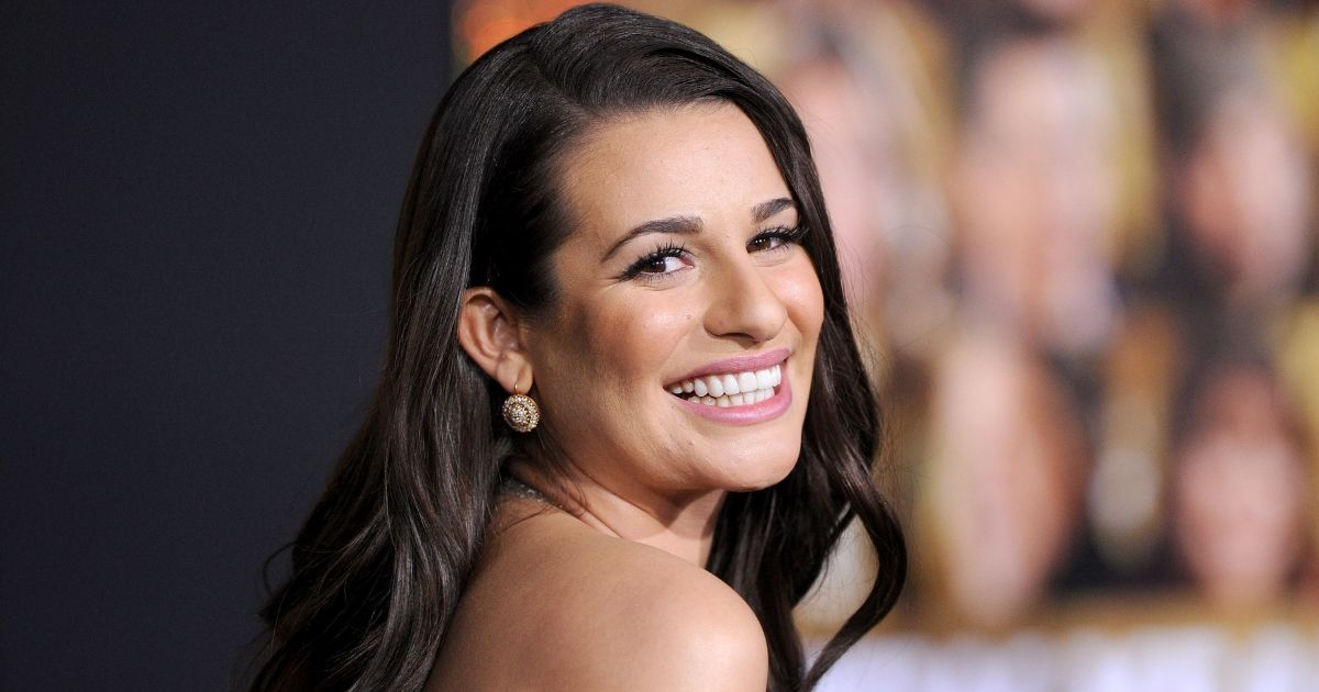 Lea Michele smiles on a red carpet appearance from 2011