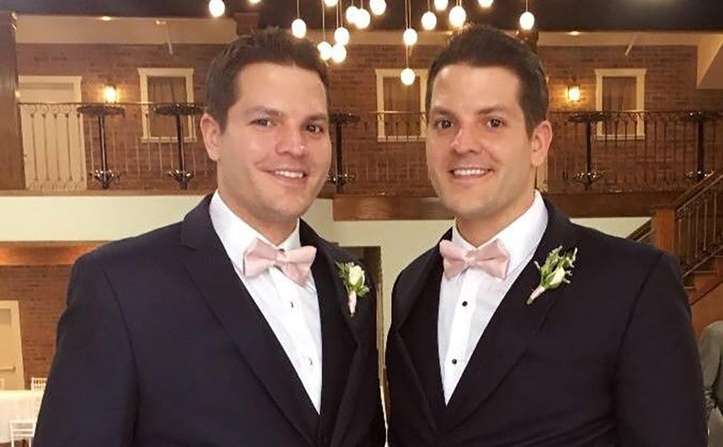 Wearing matching tuxedos
