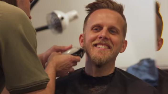 hero getting a haircut