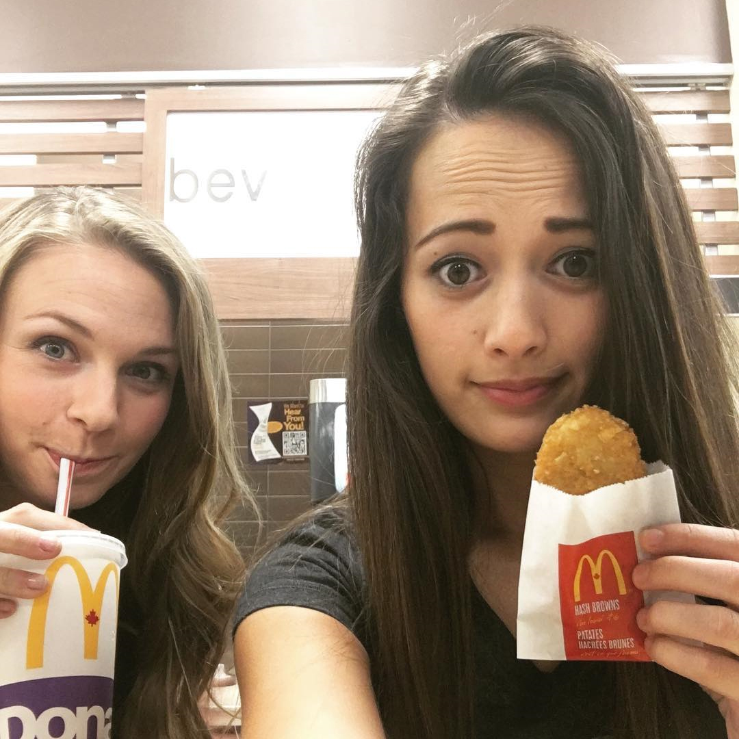 holding a hashbrown