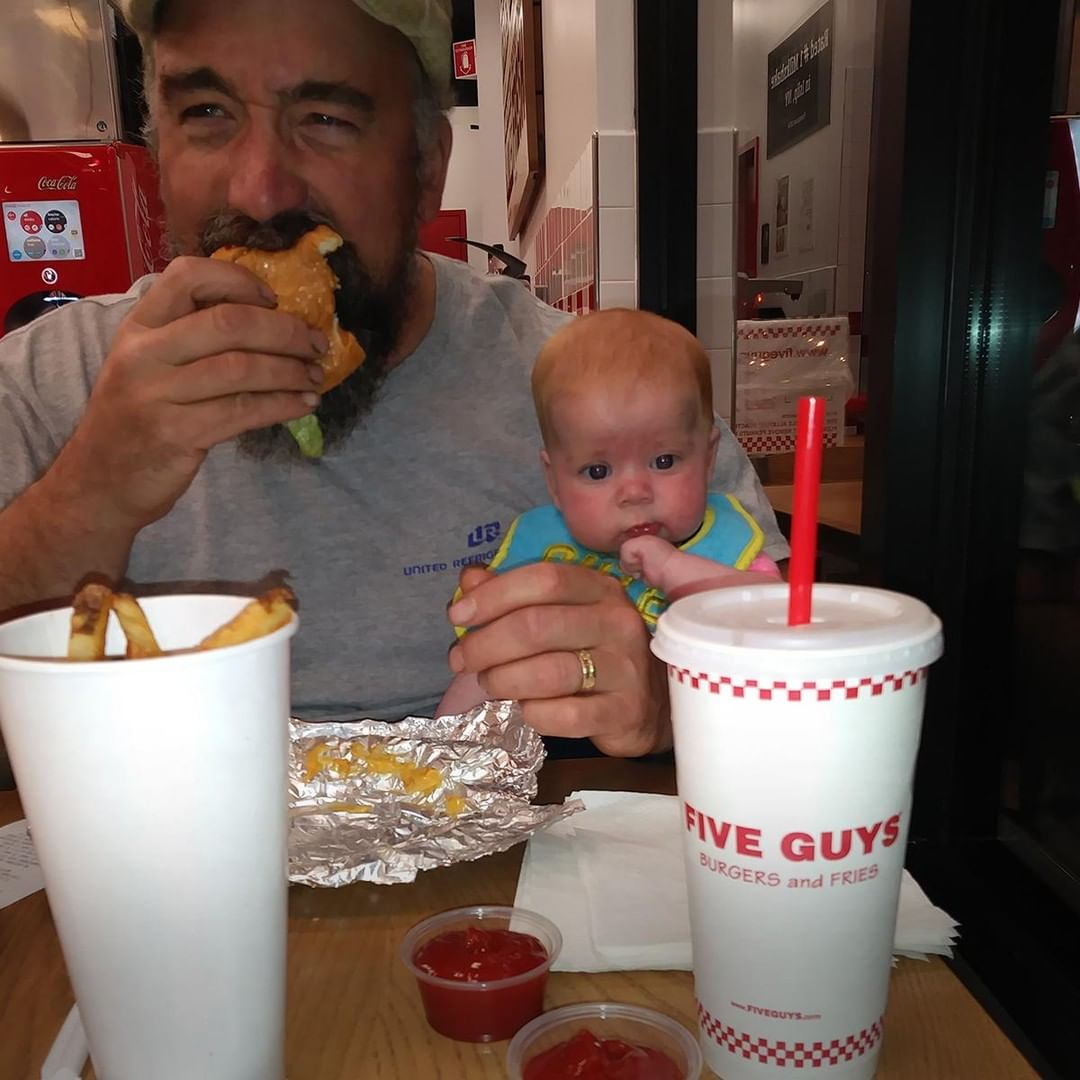 man eating with baby