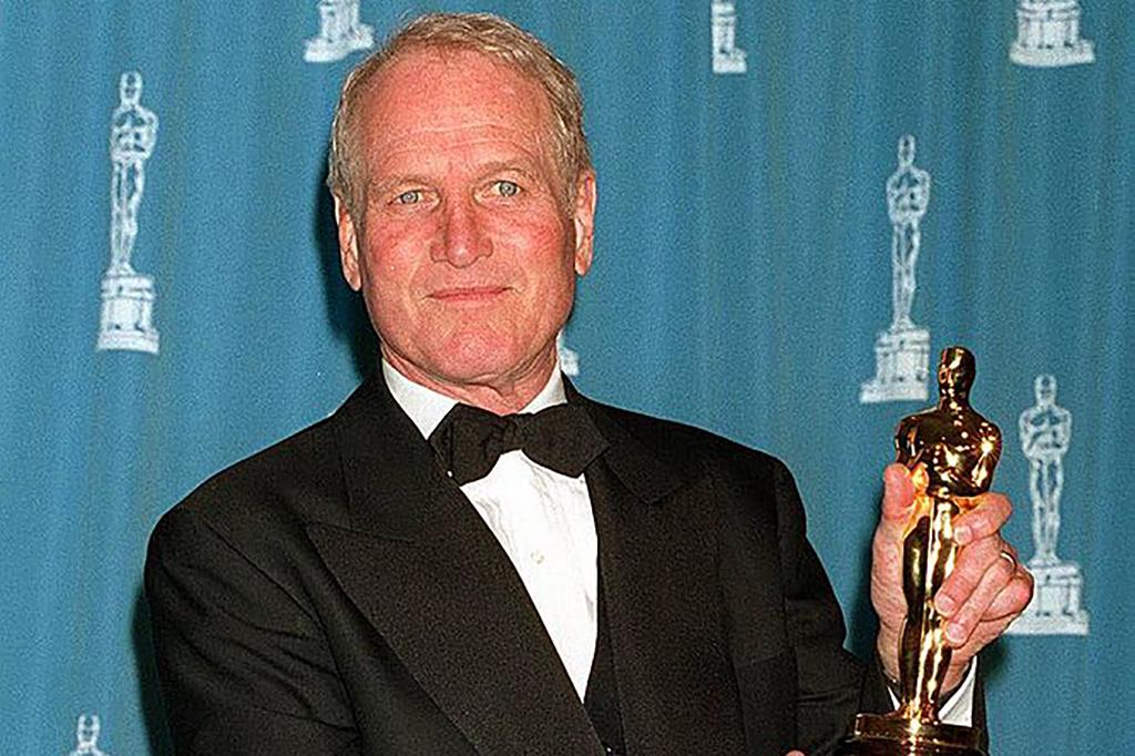 Newman holding an Oscar