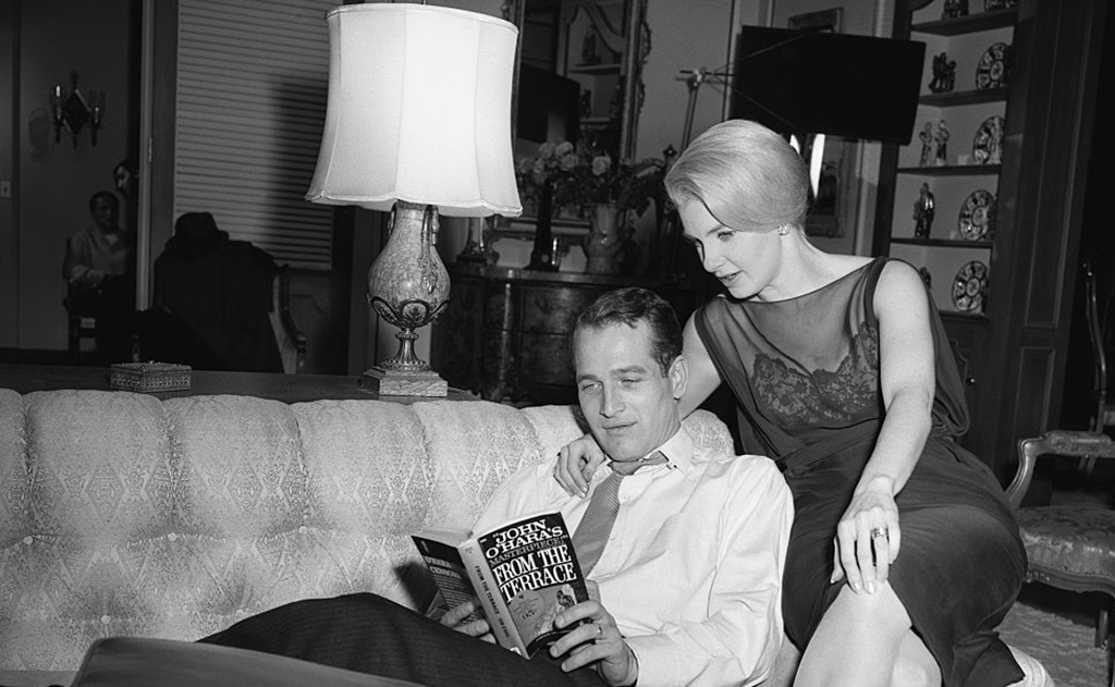 Newman reading a book with his wife