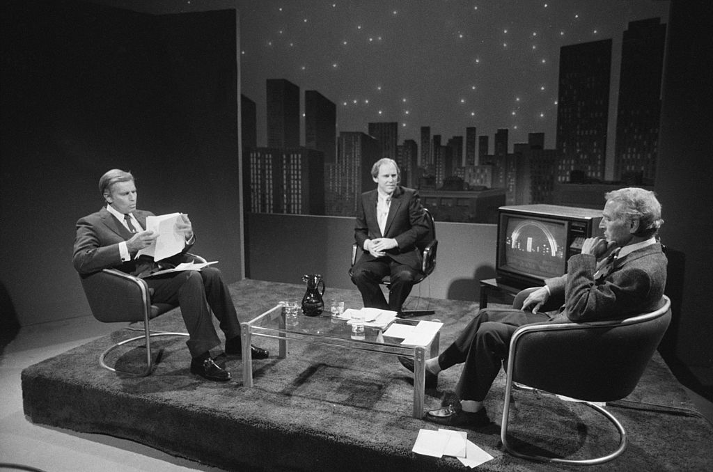 Newman and Heston TV debate