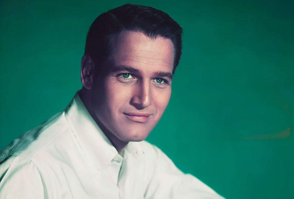 Paul Newman posing in front of green background