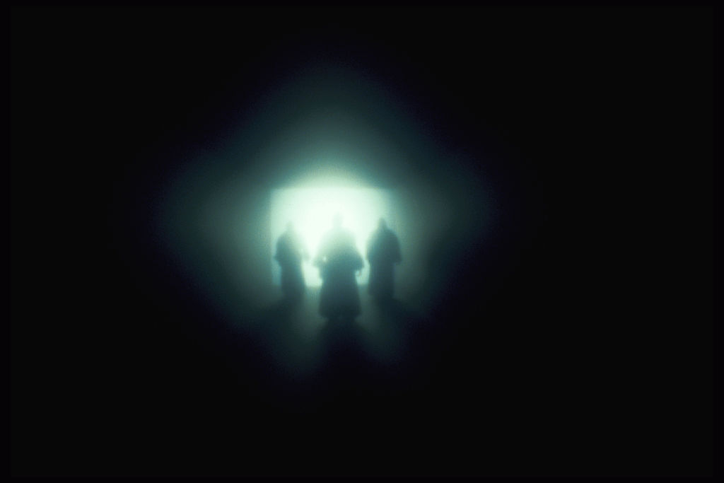 ghostly figures in the light