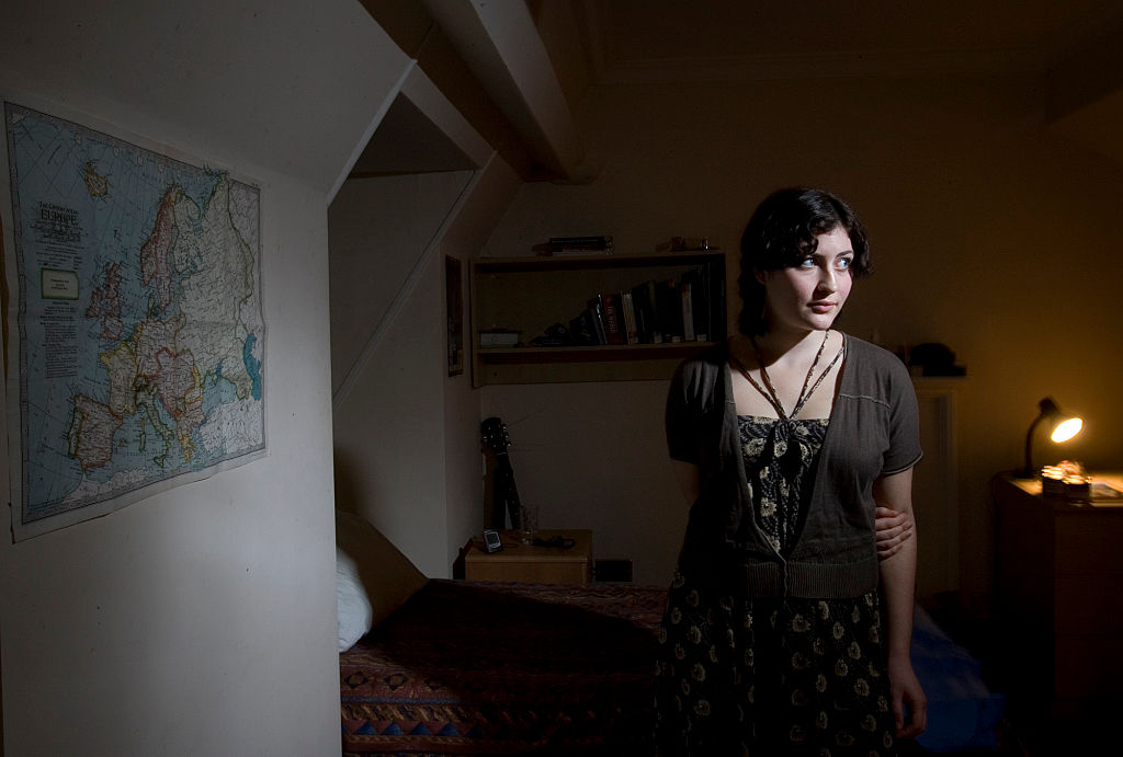 woman standing in the middle of a room