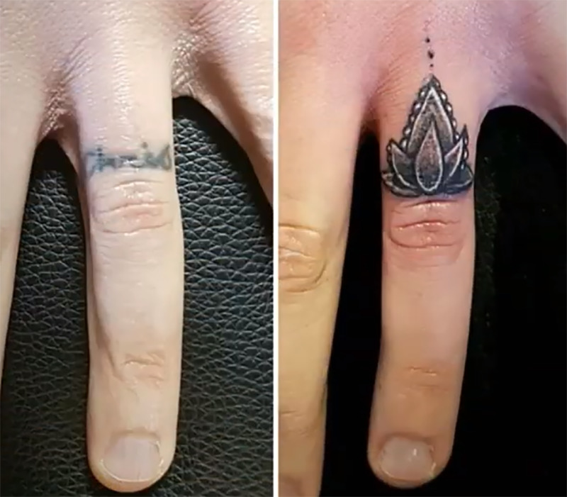A name on a woman's ring finger is covered with a tiny flower tattoo.
