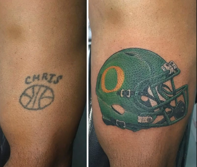 A tattoo of the name Chris and a basketball are covered with a football helmet.