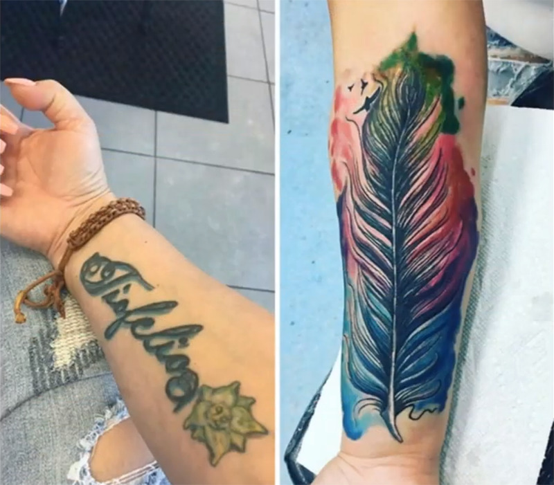 A name tattoo is covered up with a colorful feather on the forearm.