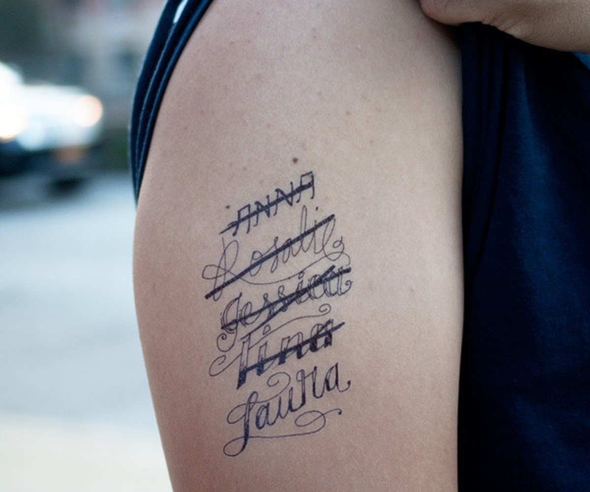 A list of girl's crossed out names are tattood on someone's arm.