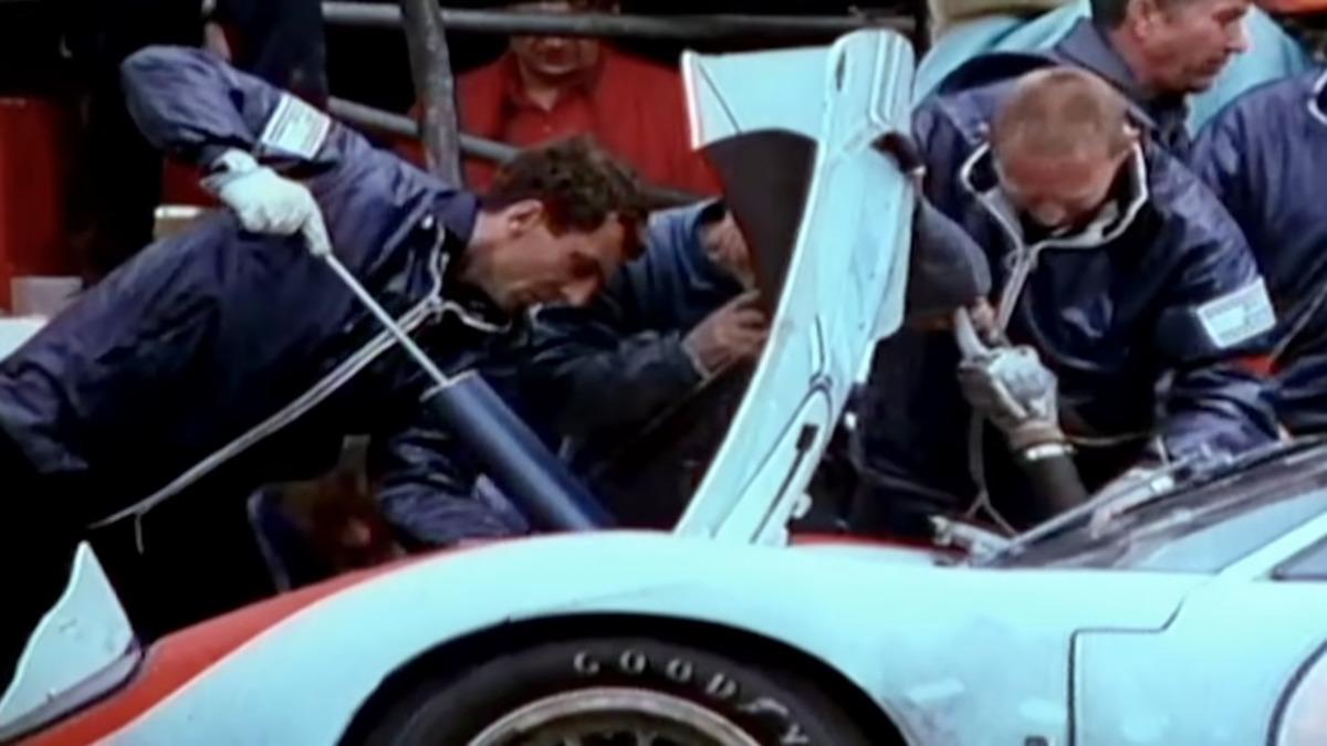 Mechanics work on a racecar.