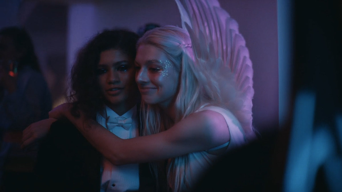 zendaya and hunter schafer in costumes giving each other a hug