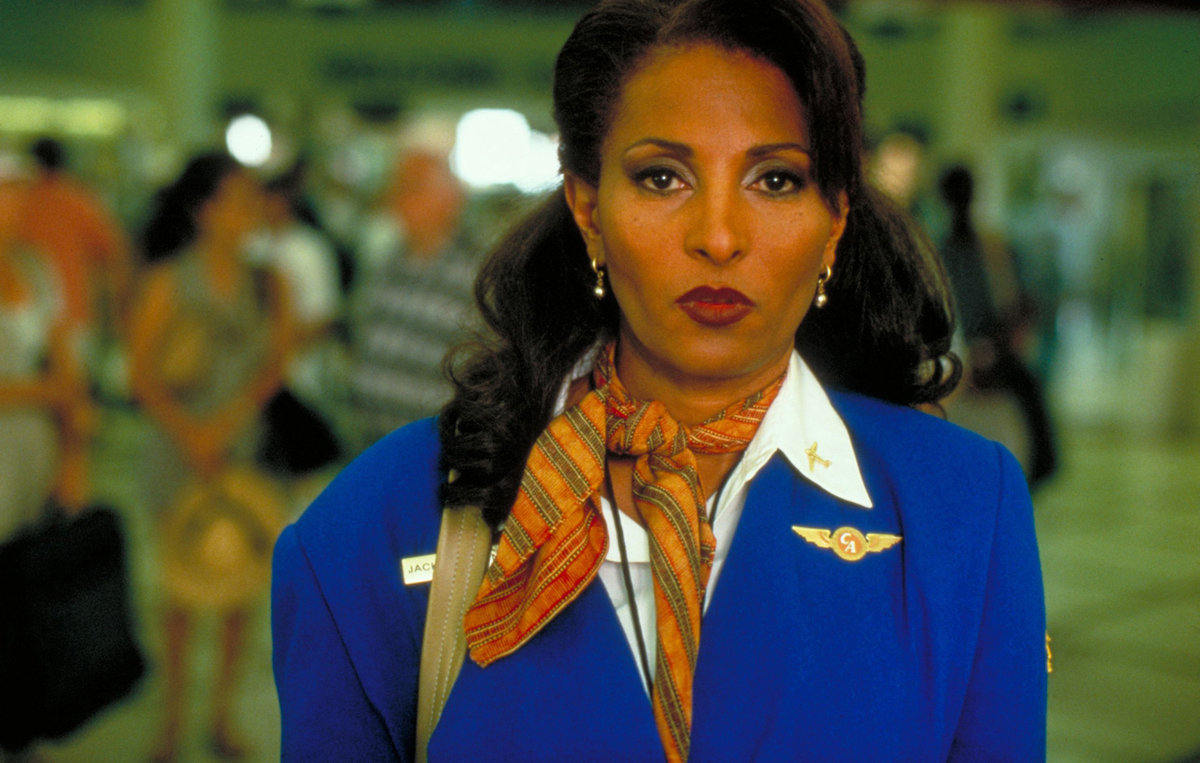 A flight attendant wears a determined expression.