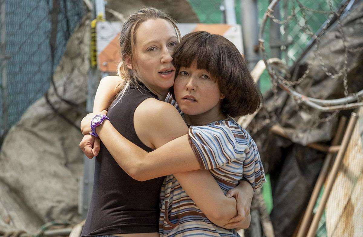 Maya Erskine and Anna Konkle giving each other a hug