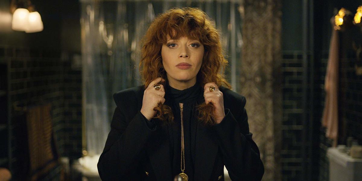 natasha lyonne pulling her red, curly hair