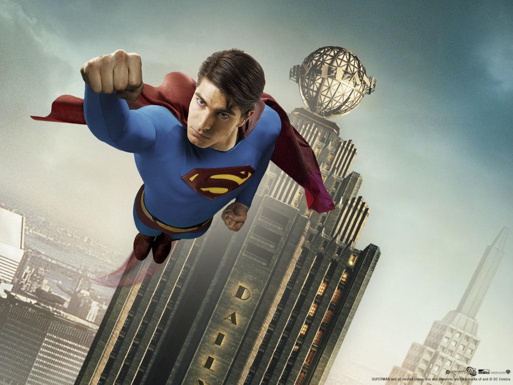Superman flies past a building.