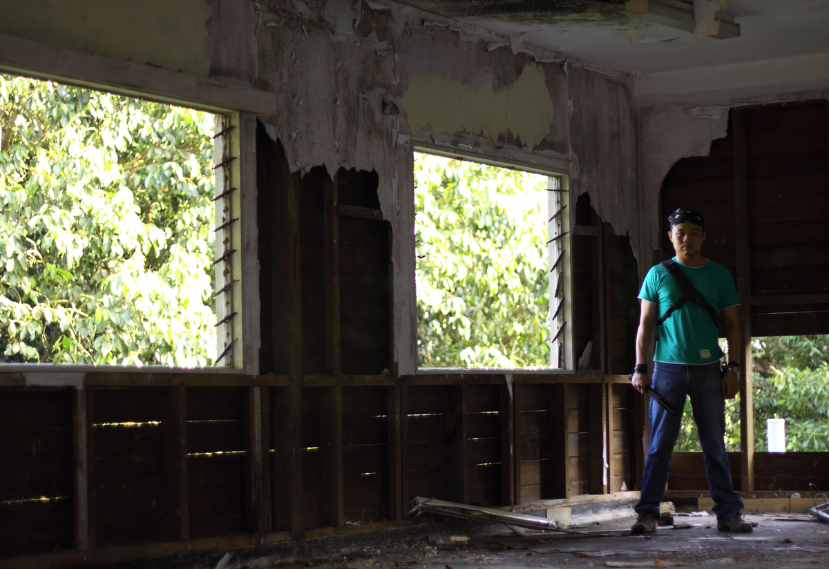 An urban explorer stands in the abandoned Changi Hospital.