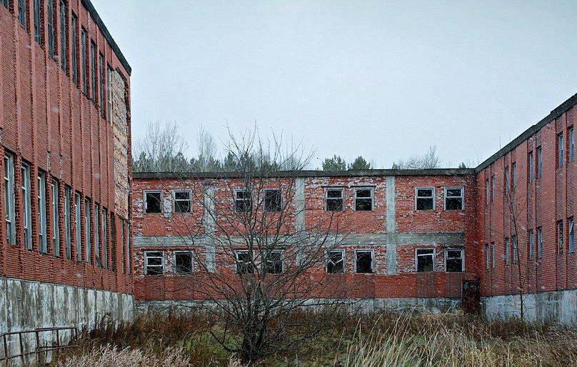 Abandoned red brick buildings are seen in Canada.
