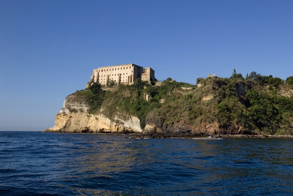 The abandoned prison on Procida Island, Italy is seen from a distance.