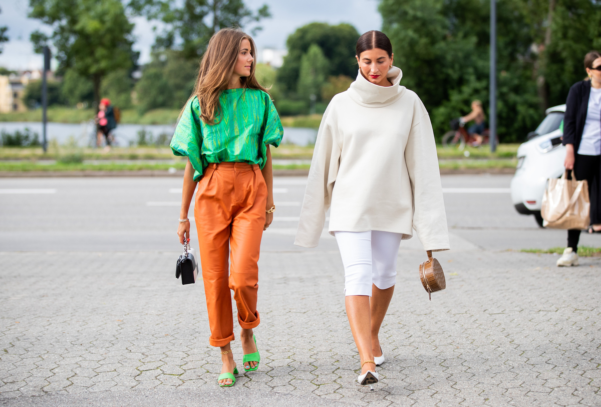 Women wear capris while walking through Denmark.