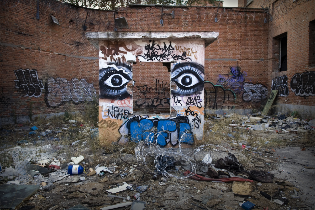 Graffiti and rubble covers the ruins of Carabanchel Prison, Spain.