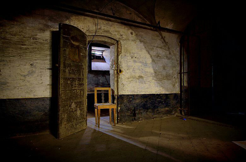 A chair stands in an open door in Tuchthuis Prison, Belgium.