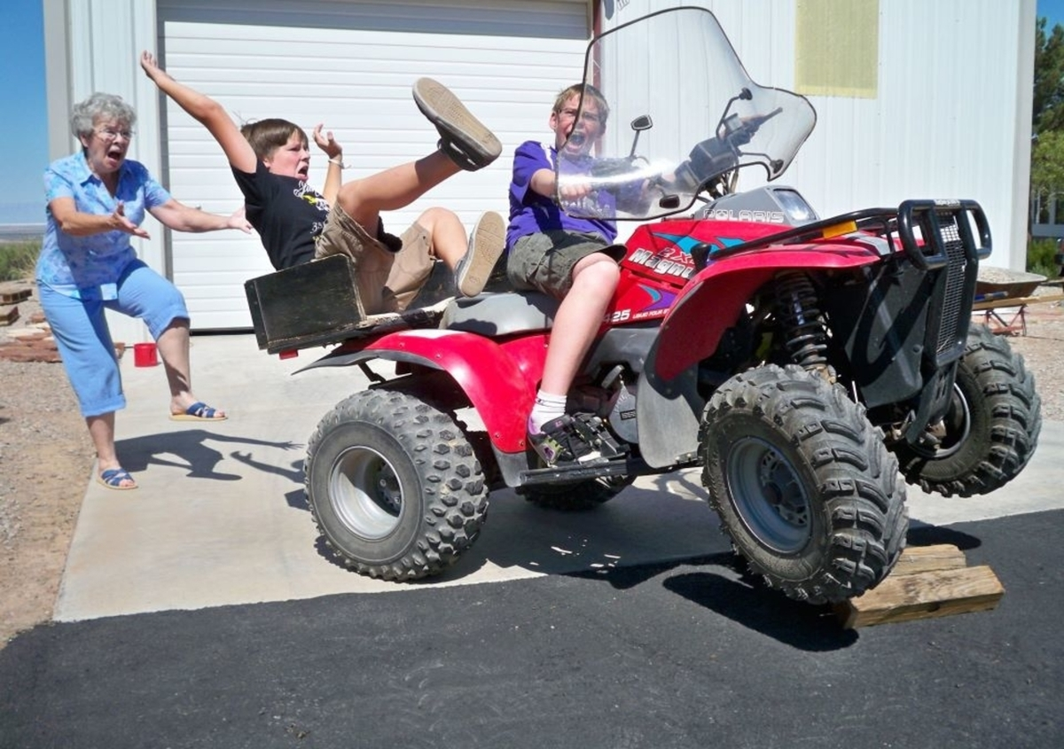 boy-falling-off-four-wheeler