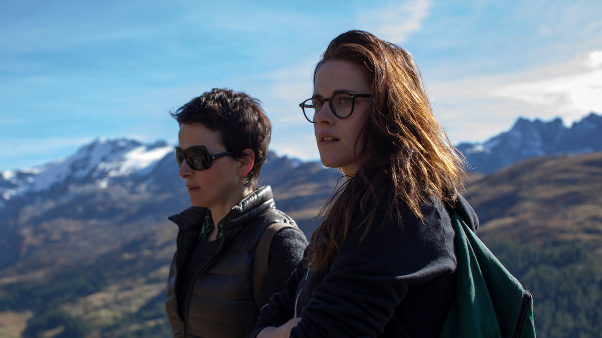 An actress and her assistant hike the mountains in the movie Clouds of Sils Maria.