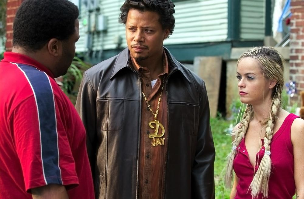 A group of people talk in the movie Hustle and Flow.
