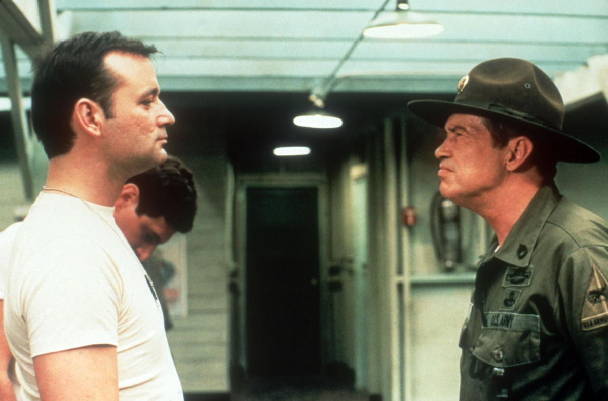 Bill Murray faces a military officer in the movie Stripes.