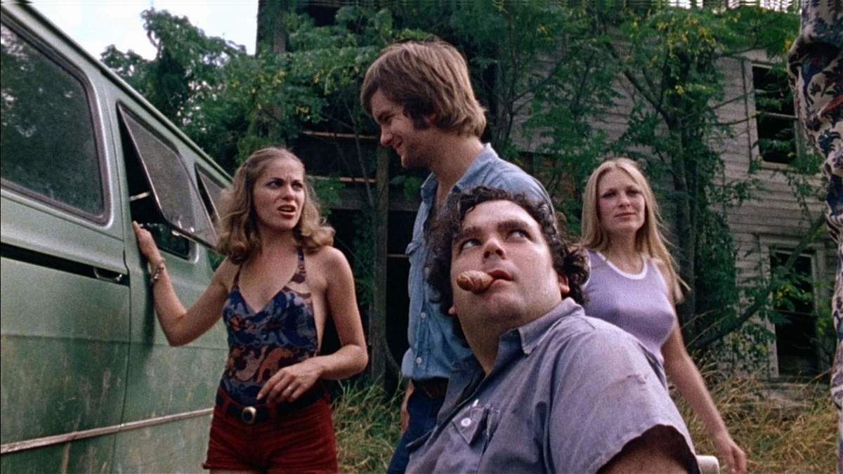 Teenagers stand by a car in the Texas Chainsaw Massacre.