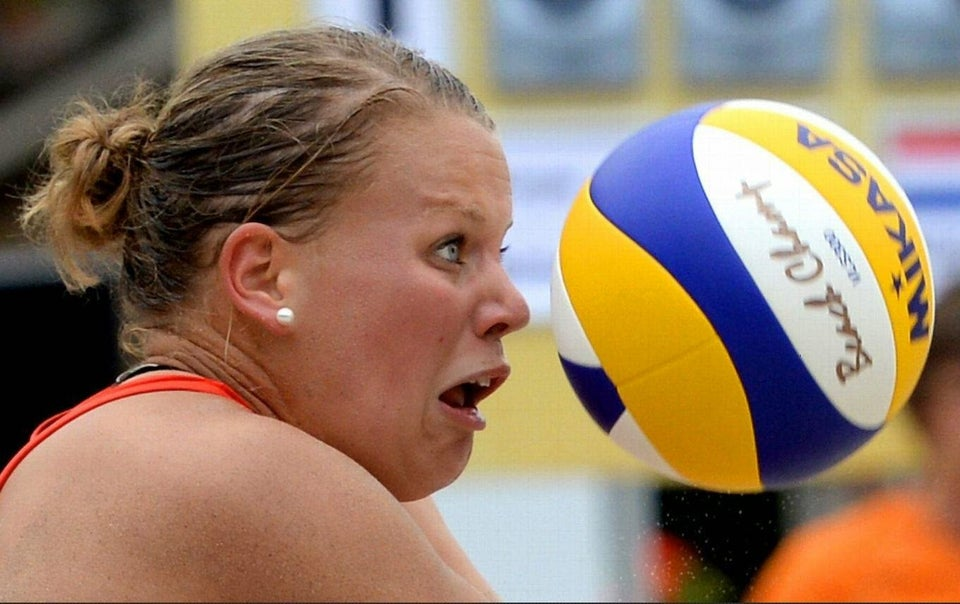 woman-about-to-be-struck-in-the-face-by-volleyball