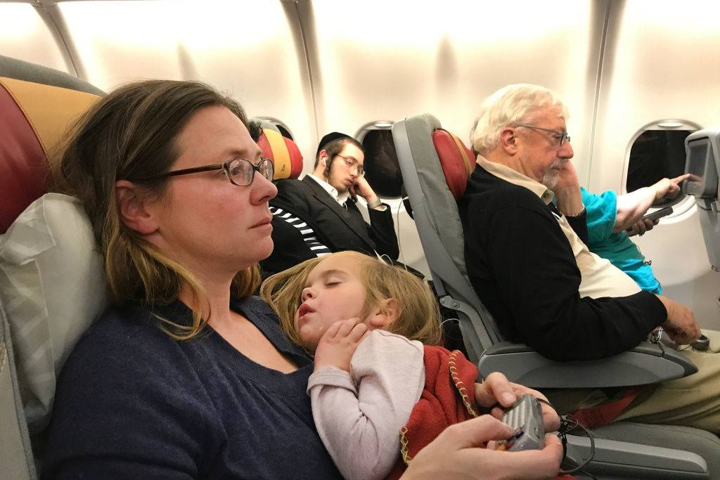 woman on plane with a child