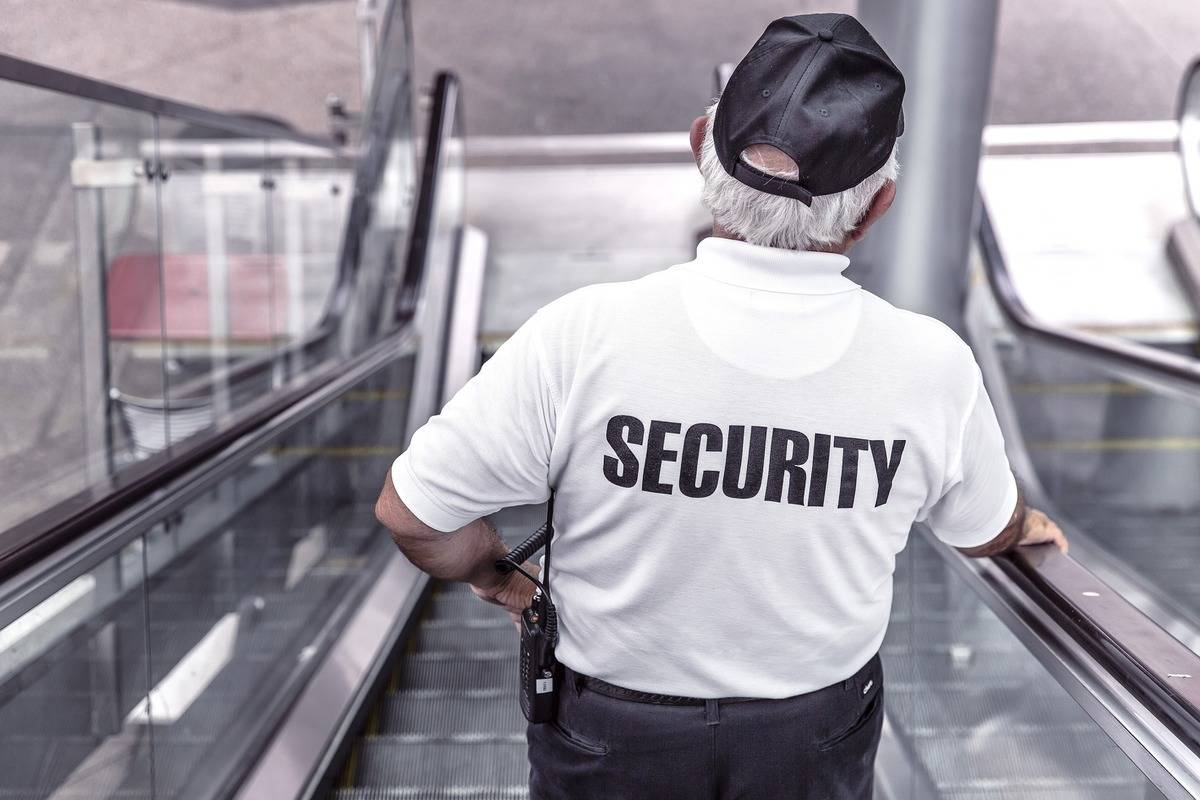 security going down an escalator
