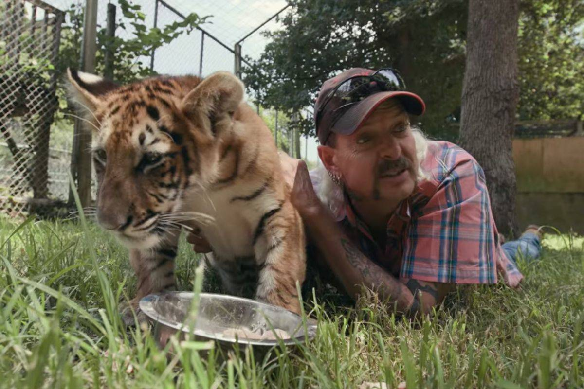 joe exotic with a baby tiger