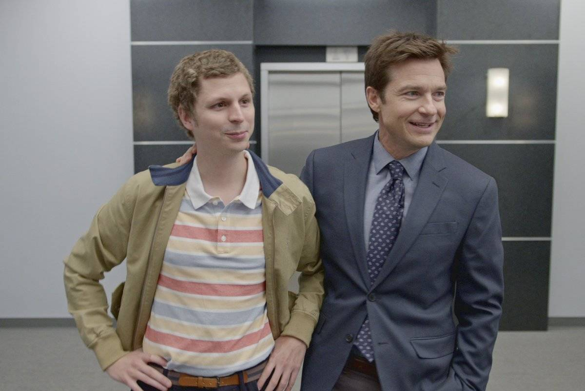 michael cera and jason bateman standing in front of an elevator