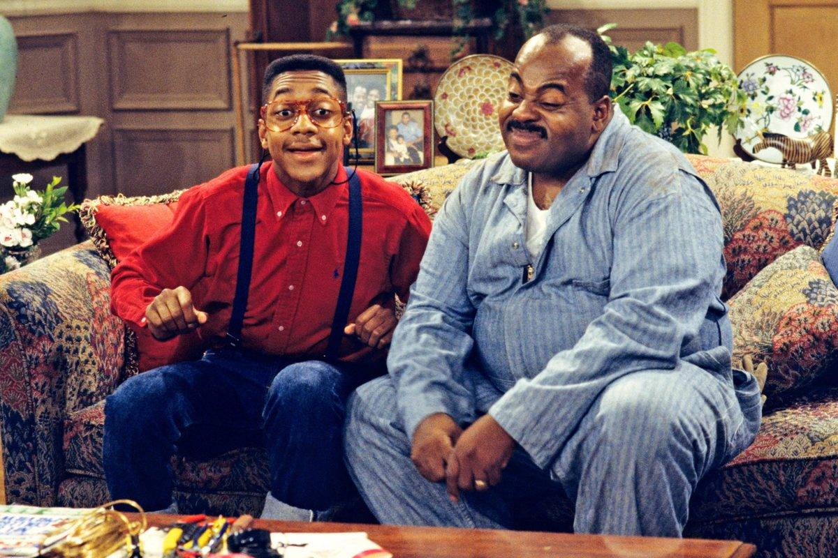 urkel and carl sitting on a couch