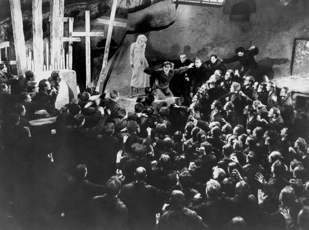 people crowded  around an actress in a still from Metropolis