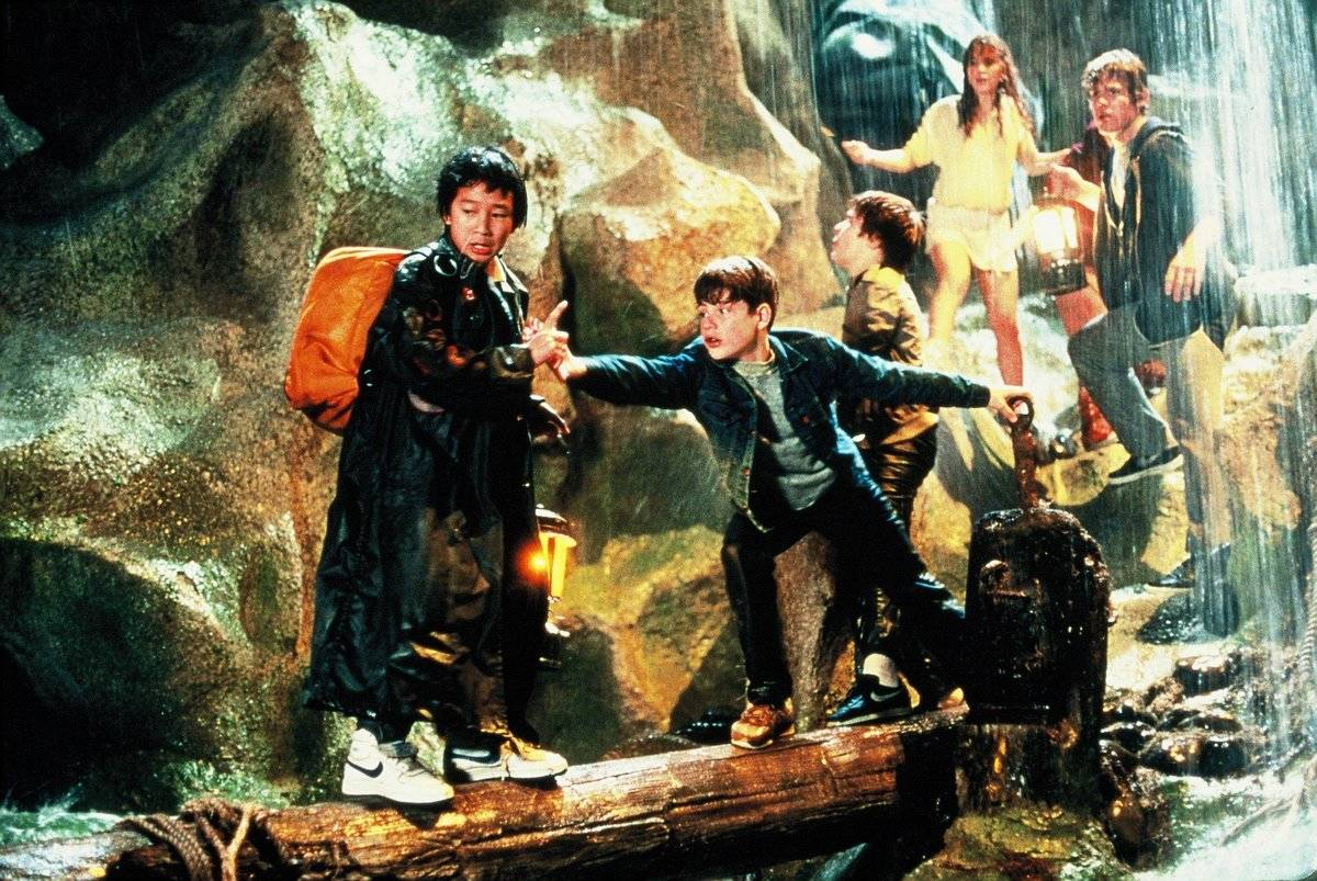 the goonies cast going over a log on set