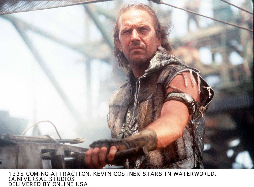 kevin costner in a tattered vest in waterworld
