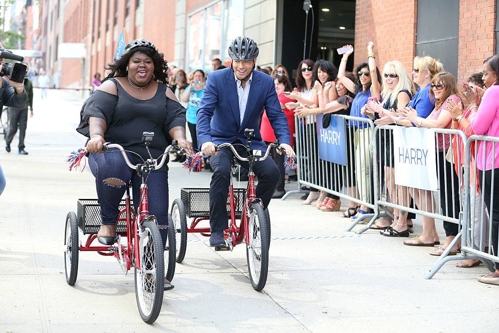 harry connick jr and gabourey sidibe riding tricycles on Harry