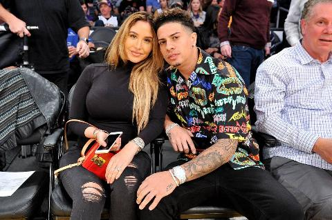 Austin McBroom and Catherine Paiz attend a Lakers basketball game.