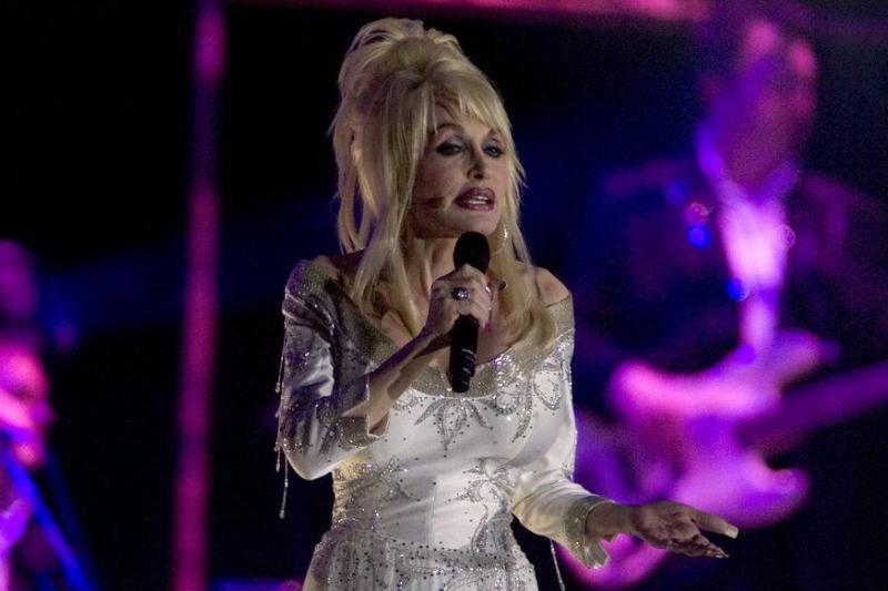 Dolly Parton performs onstage.