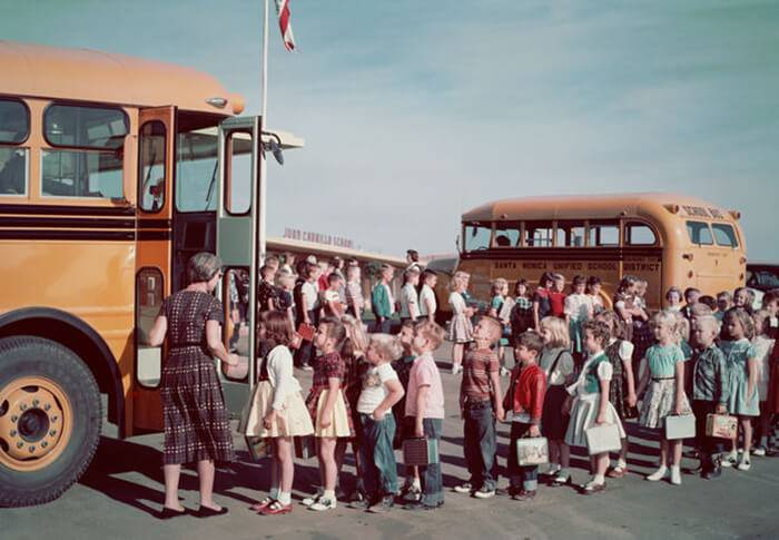 Kids Lining Up For The School Bus